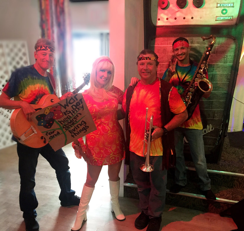 Throwback decades Band https://www.throwbackdecadesband.com/ 80s band serving Ybor City, Fl. 60s, 70s, theme cover band for Woodstock theme parties.